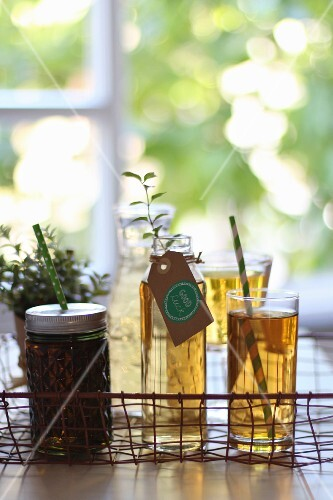 Assorted tea glasses on a wire basket tray
