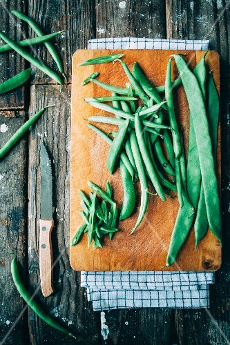 Assorted green beans on a chopping board