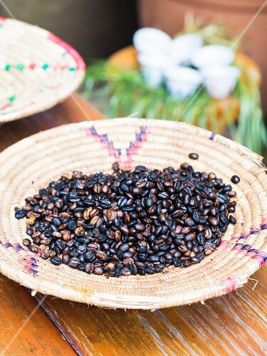 A basket full of Ethiopian coffee beans roasted during the traditional coffee ceremony
