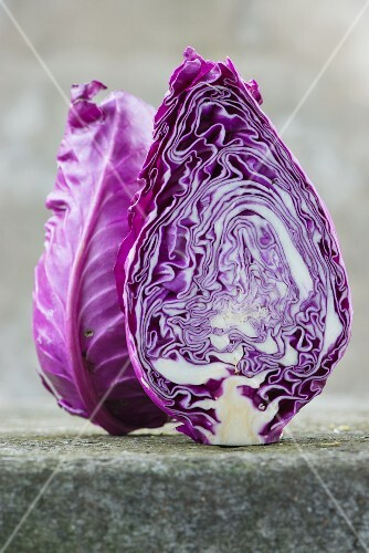 A red pointed cabbage sliced in half
