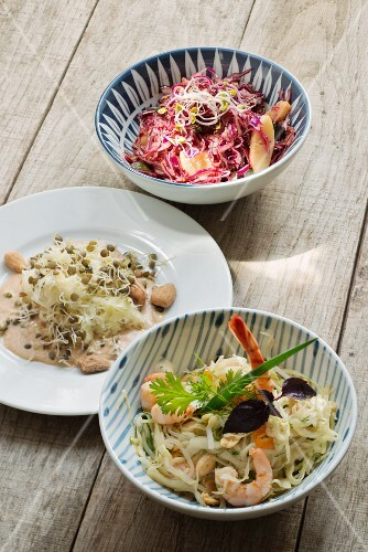 Three types of cabbage salad with red cabbage, white cabbage and sauerkraut