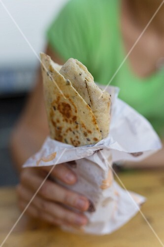 A hand holding a wrap