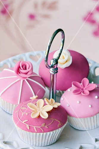 Gourmet cupcakes decorated with fondant and sugar flowers