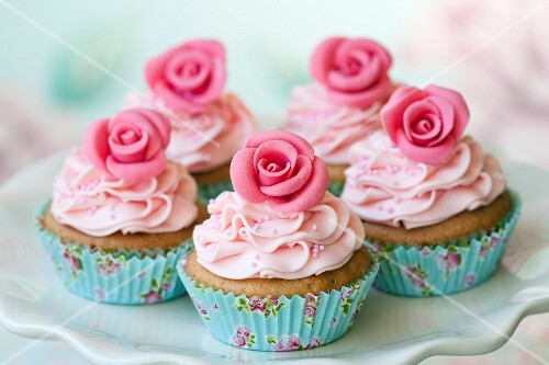 Cupcakes decorated with sugar roses