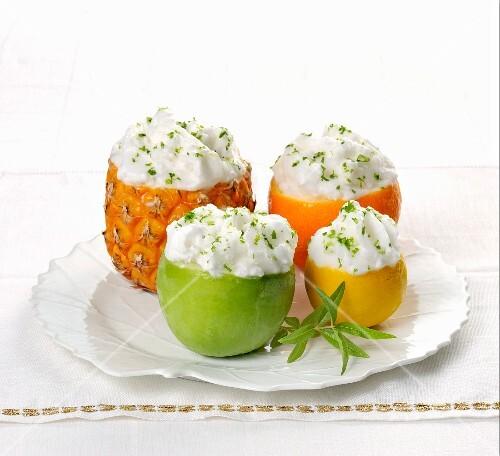 Assorted fruit sorbets served in fruit