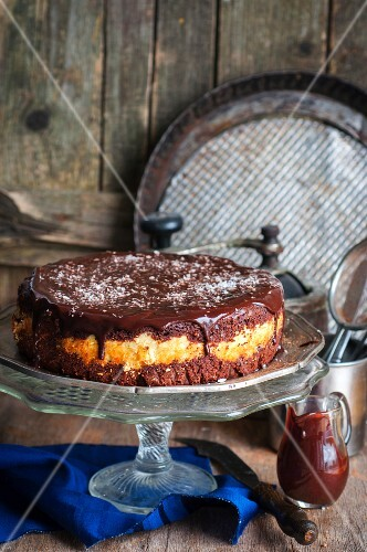 A chocolate cake with a coconut filling and ganache