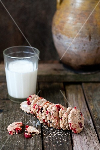 Healthy oat biscuits with dried cranberries and a glass of milk