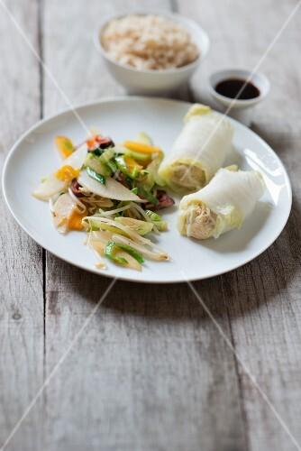Filled Chinese cabbage rolls with wok vegetables