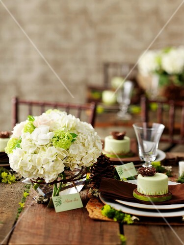 Bouquet of white hydrangeas on rustic wedding table