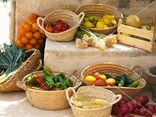 A Mediterranean arrangement of vegetables, citrus fruits and melons