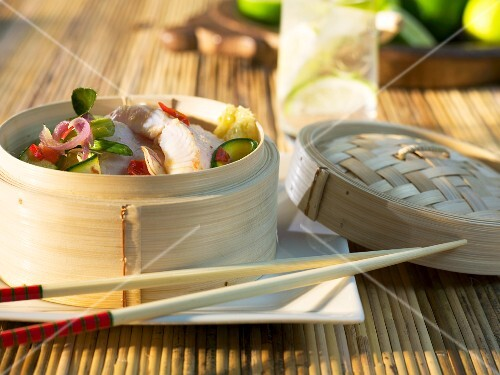 Fish and vegetables in a bamboo steamer (Asia)