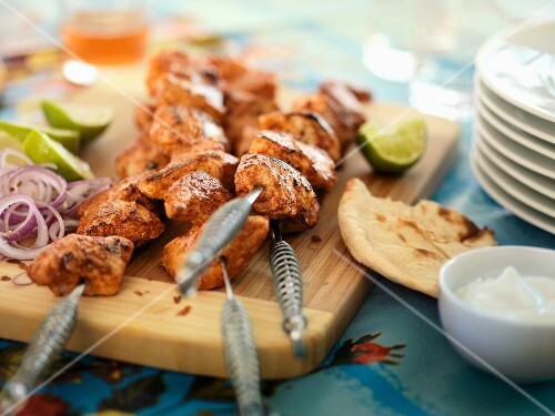 Spicy chicken kebabs with flatbread and lime