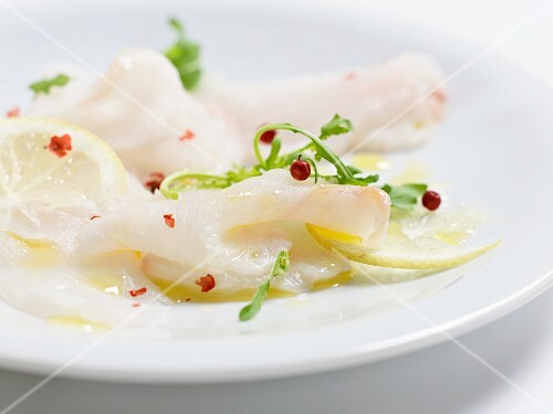 Fish carpaccio with lemons and red peppercorns