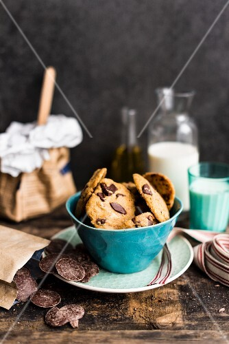 Olive oil chocolate chip cookies in a turquoise bowl