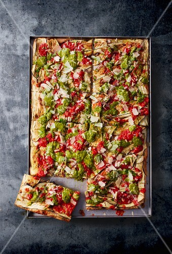 Pizza with aubergine and pesto in a baking tray