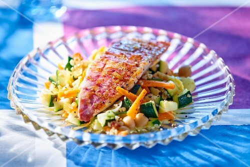 Red mullet on a bed of courgette and carrots