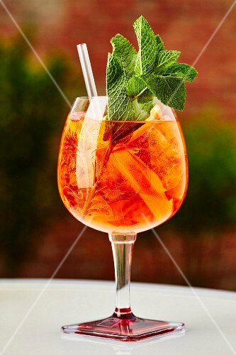 A cocktail with Aperol and fresh mint
