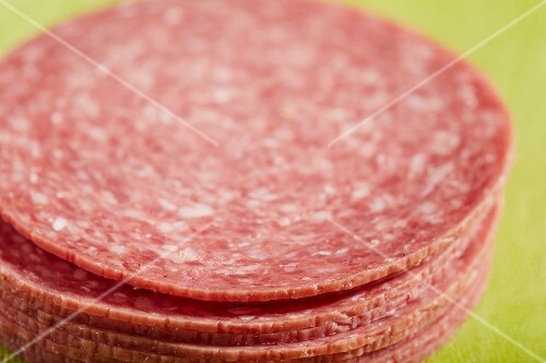 A pile of slices of American beef salami