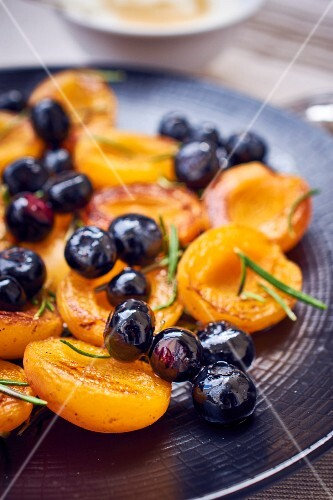 Roasted apricots and blueberries with rosemary