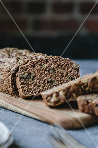 Slices of a loaf of vegan zucchini and walnut bread