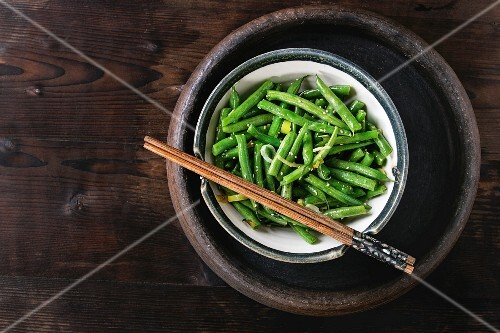 Green beans with onion and sesame seeds in a dish