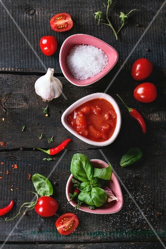 Ingredients for tomato ketchup: chopped tomatoes, salt, herbs, garlic and chilli peppers