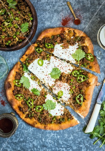 Lamb keema with yoghurt and chilli on a pizza