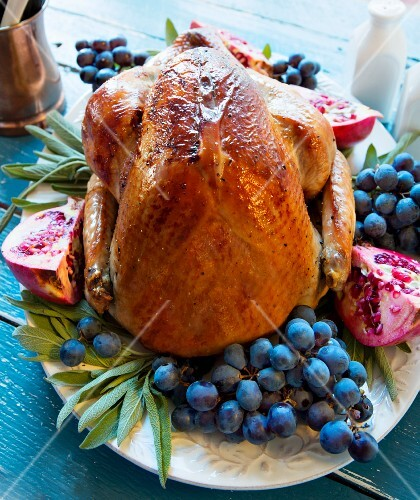 Roast turkey with grapes, pomegranate and sage