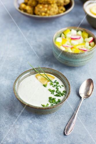 Charred lemon tzatziki, veggies, charred broccoli falafel, charred lemon tahini and pita bread
