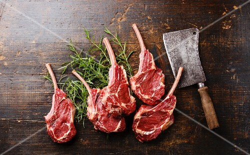 Raw fresh meat Veal ribs and Meat cleaver on wooden background