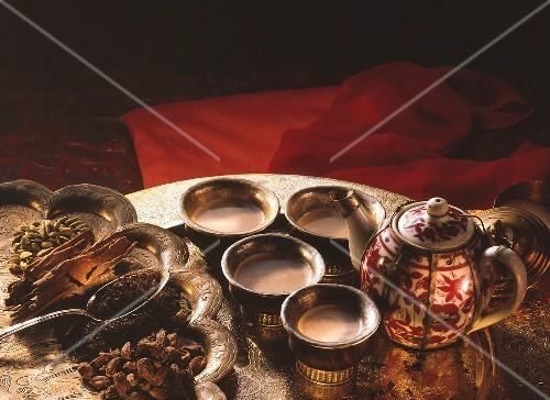 Spiced tea with cinnamon, cardamom, cloves & milk in bowls