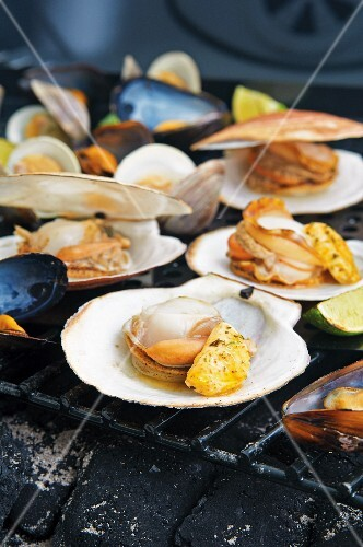 Grilled clams with lime & garlic butter on a grill rack