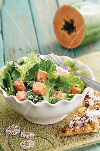 Cos lettuce with papaya chunks and Parmesan