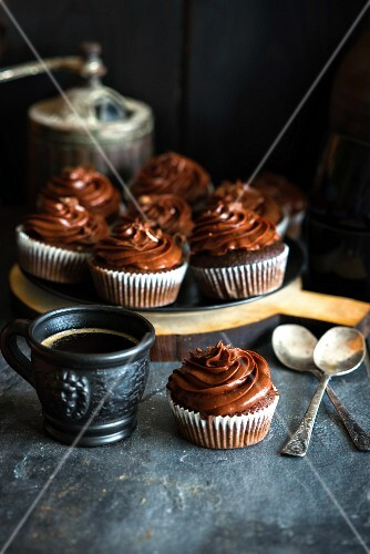 Chocolate cupcakes with rich chocolate frosting and a cup of coffee