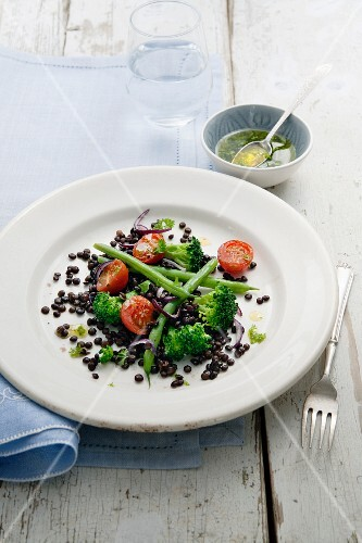 Lentil salad with broccoli, onion, green beans and tomatoes with a honey, mustard and herb dressing