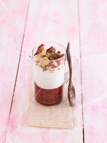 Vegan cashew cream with strawberry marmelade and a crunchy topping