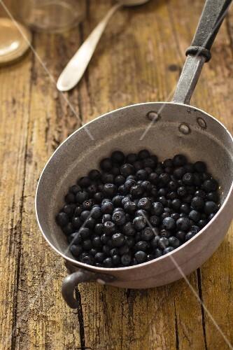 Wild blueberries in an old kitchen colander