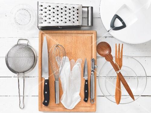 Assorted kitchen utensils for preparing salads