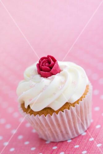 Mini cupcake decorated with a sugar rose