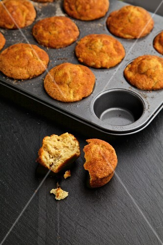 Cinnamon and apple muffins on a dark background