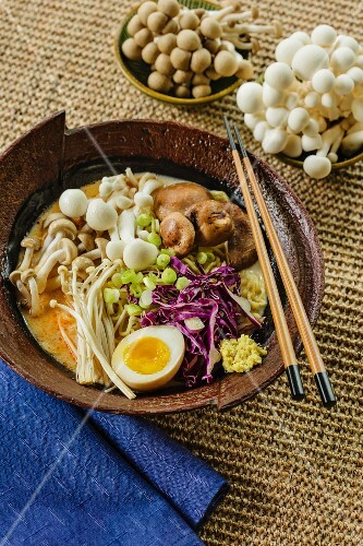 Japanese ramen soup with mushrooms, red cabbage and egg