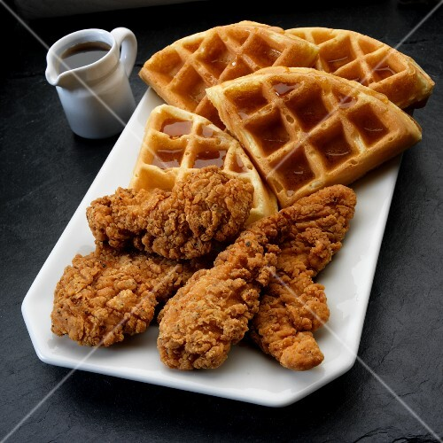 Fried chicken in breadcrumbs with syrup waffles