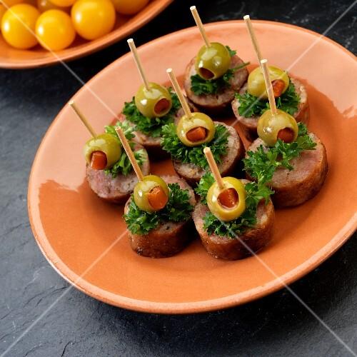 Spanish tapas bites with chorizo, olives and parsley