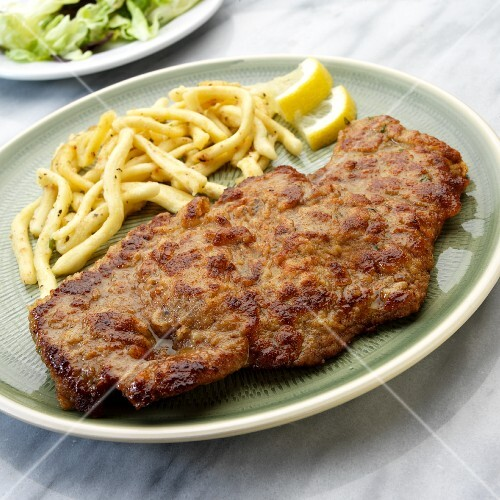 Wiener Schnitzel (breaded veal escalope from Vienna) with Spätzle (soft egg noodles from Swabia)