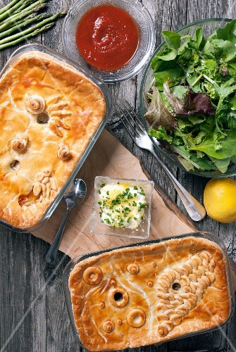 A chicken and salmon tourtière served with a mixed salad