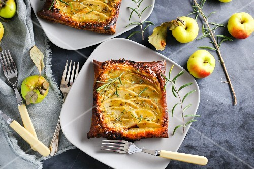 Apple tart with rosemary on a plate