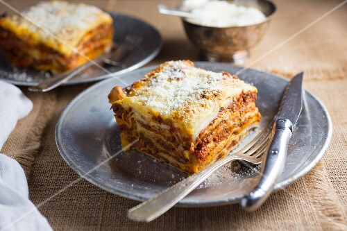 Piece of Lasagna on a White Plate; White Background