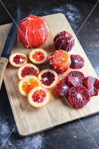 Sliced blood oranges on a chopping board