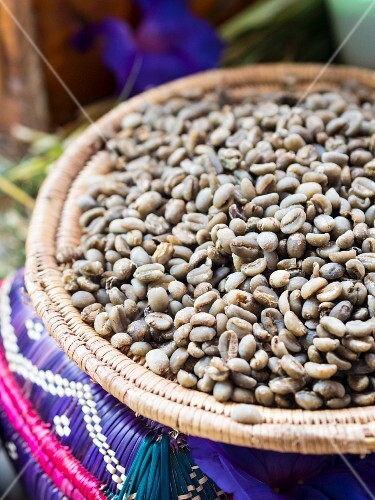 Green coffee beans in a basket for a coffee ceremony in Ethiopia