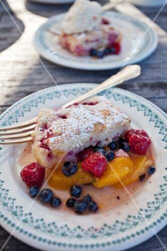 Peach, raspberry and blueberry cobbler on plates